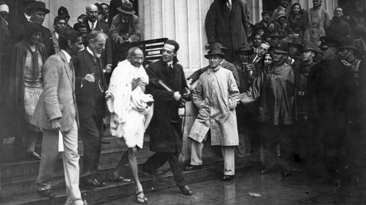 Gandhi leaves a meeting in London in 1931.