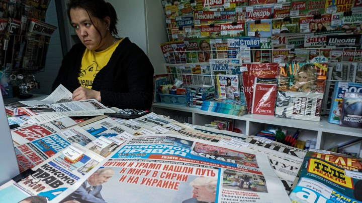 A woman looks at newspapers at a Moscow newsstand in 2017.