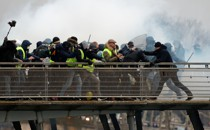 Yellow-vest protesters clash with police in Paris in January 2019.