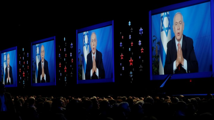 Speaking via satellite feed from Israel, Israeli Prime Minister Benjamin Netanyahu addresses AIPAC on March 26.