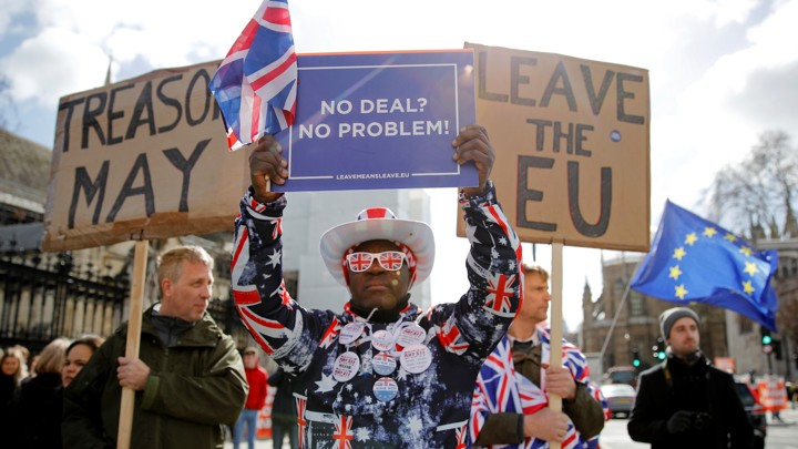 Protesters outside the Houses of Parliament, ahead of a Brexit vote in London on March 13, 2019