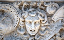 A medusa head carved in stone