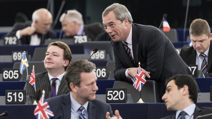 The Brexit supporter Nigel Farage talks with other British MEPs during a European Parliament session in Strasbourg in March.