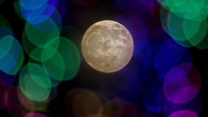 A photo of the moon through colored lenses