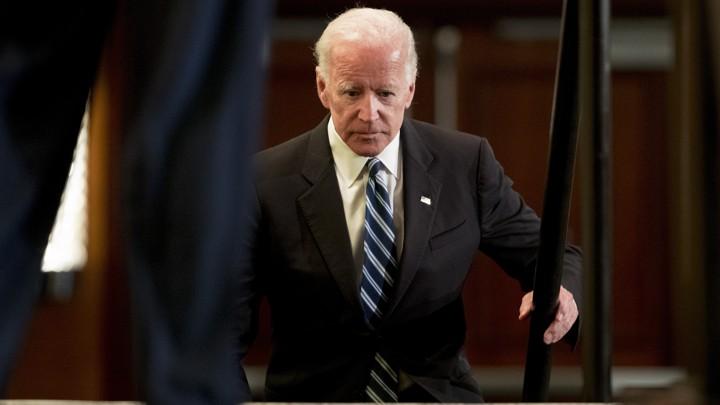 Joe Biden climbing stairs
