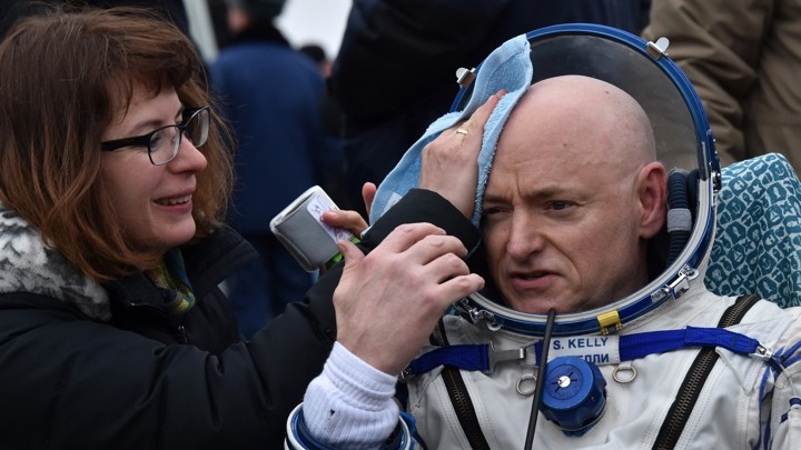 Scott Kelly rests after the landing of the Soyuz space capsule.