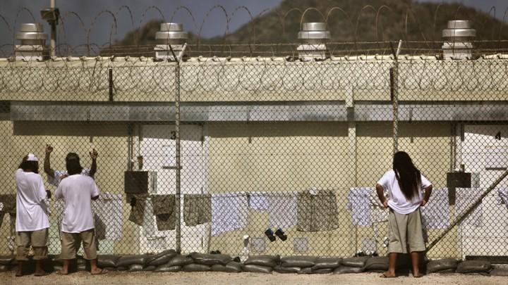 Detainees talk at the Camp 4 detention facility at Guantánamo Bay U.S. Naval Base in Cuba.