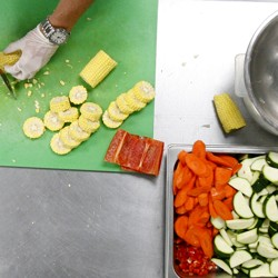 A chef at Revolution Foods prepares school lunches for California children.
