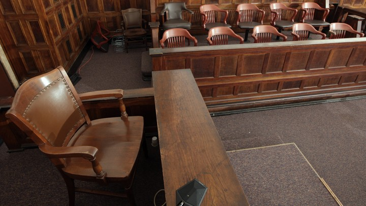 A witness stand and a jury box