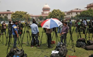 Journalists stand outside India's Supreme Court in New Delhi.