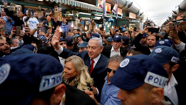 Netanyahu and his wife Sara make a campaign stop at a market in Tel Aviv.