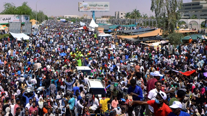 Sudanese demonstrators chant slogans during a protest in Khartoum demanding that Sudanese President Omar Al-Bashir step down.