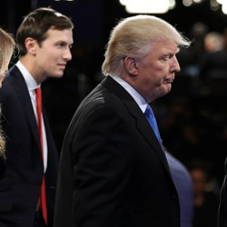 Donald Trump is flanked by his son-in-law, Jared Kushner, and his son Donald Trump Jr.