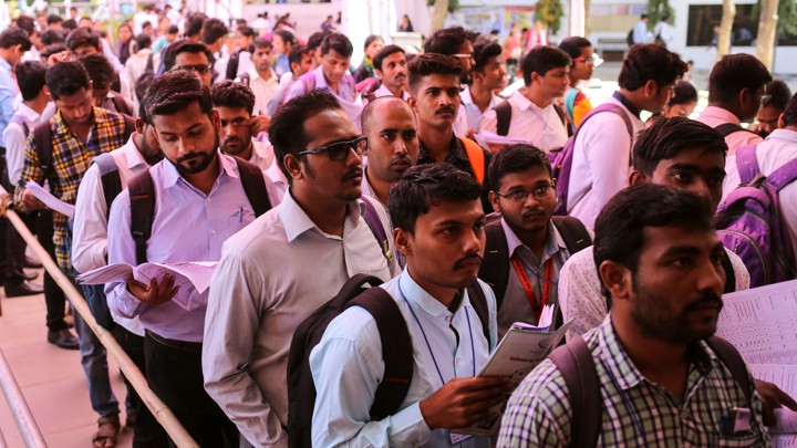 Job seekers line up for interviews at a job fair in Chinchwad, India, in February.