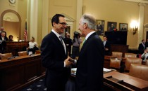 Treasury Secretary Steven Mnuchin and Ways and Means Chairman Richard Neal laugh together, in happier times.