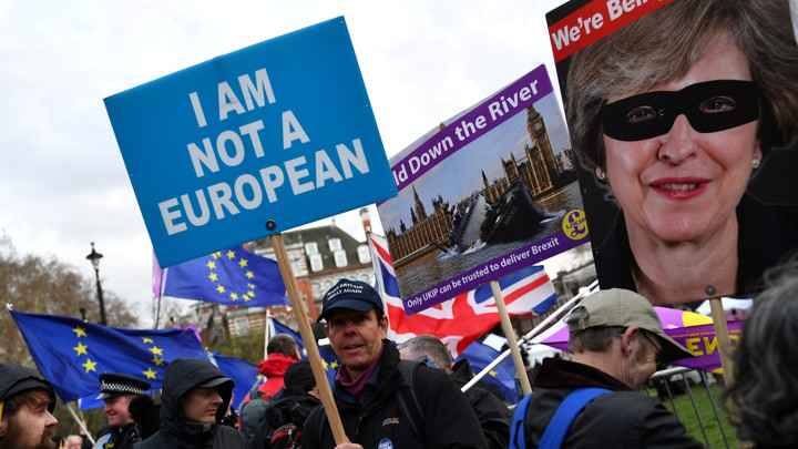 "A pro-Brexit protester holds a sign that reads ""I am not a European."""