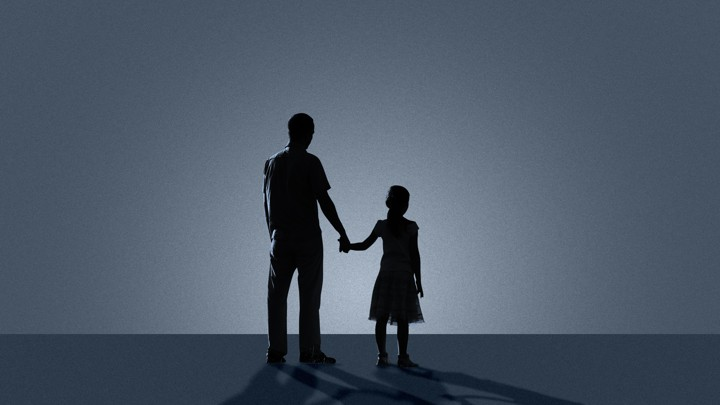 Sillhouettes of a father and daughter holding hands