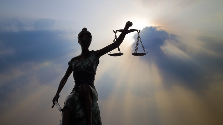 "A statue of ""Lady Justice"" holding the scales of justice"