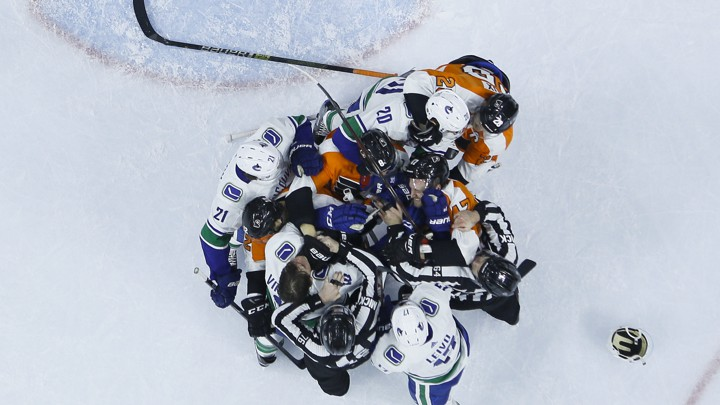 A bird's-eye view of a hockey fight