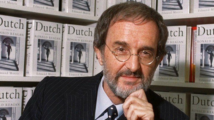 "Edmund Morris in front of a shelf of ""Dutch"" copies"
