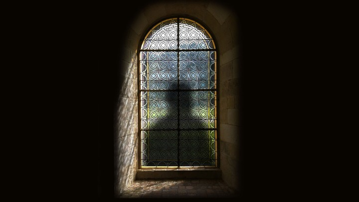 An illustration of a shadow behind a stained-glass window