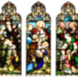 A blurred image of three stained-glass windows