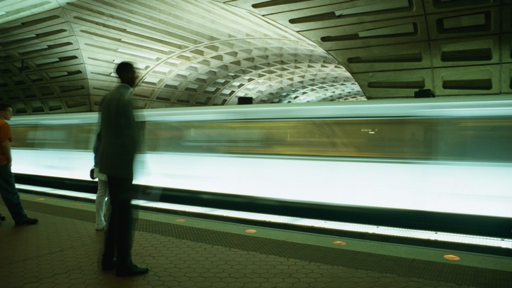 A train moves through a metro station in Washington, DC.