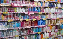 Rows of colorful cosmetics bottles