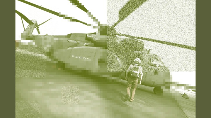 A man walks toward a helicopter
