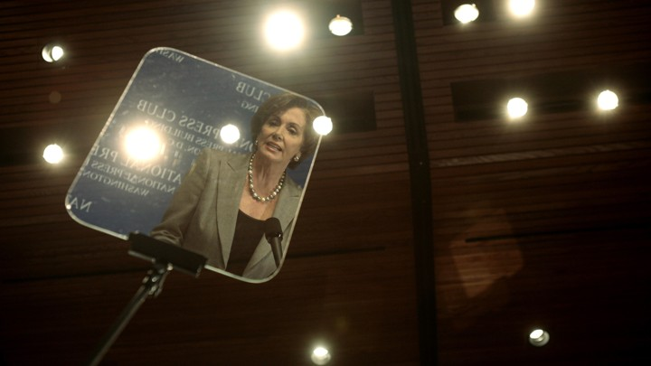 Nancy Pelosi reflected in a teleprompter in 2007