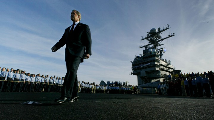 George W. Bush walked past crew members of the aircraft carrier USS Abraham Lincoln on May 1, 2003, to declare major combat in Iraq over.