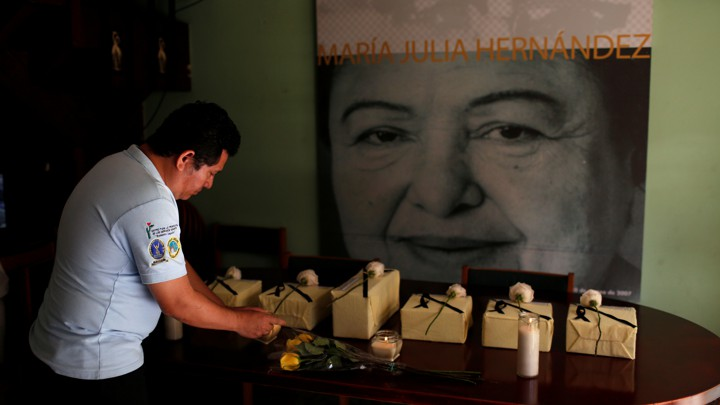 The urns of six victims of the El Mozote massacre are seen during a wake in San Salvador, El Salvador, on December 7, 2018.