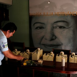 The urns of six victims of the El Mozote massacre are seen during a wake in San Salvador, El Salvador on December 7, 2018
