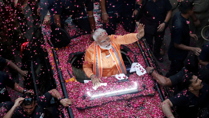 Narendra Modi waves to supporters in Varanasi in April.