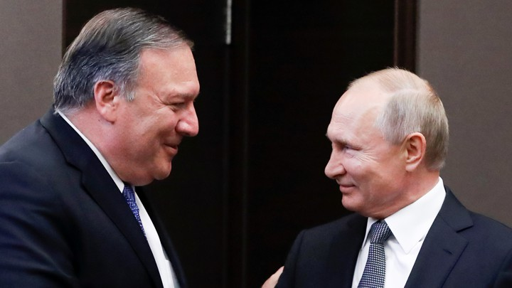 Mike Pompeo and Vladimir Putin greet each other before a meeting in Sochi, Russia.