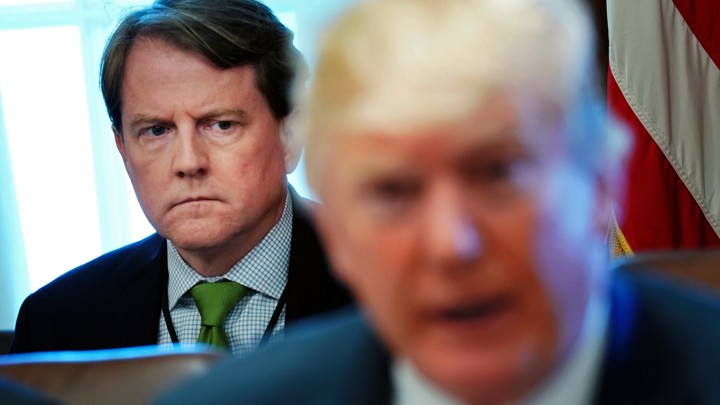 White House Counsel Don McGahn sits behind President Donald Trump at a Cabinet meeting in the White House.