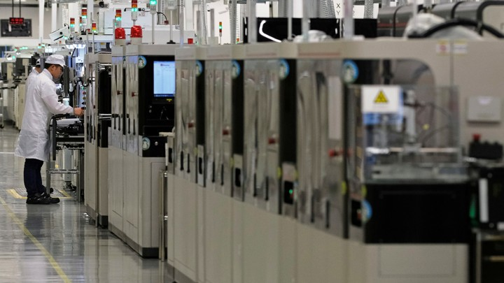 An employee works on a mobile-phone production line at Huawei's factory campus in Dongguan, Guangdong province, China on March 25, 2019.