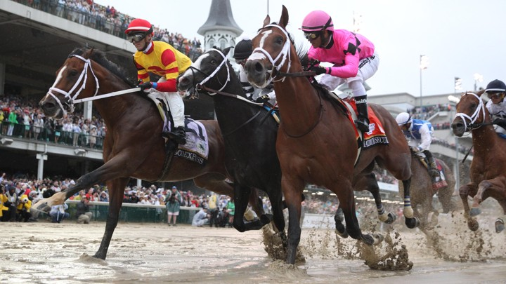 Chris Landeros aboard Bodexpress (left) races Luis Saez aboard Maximum Security (right) during the 145th running of the Kentucky Derby