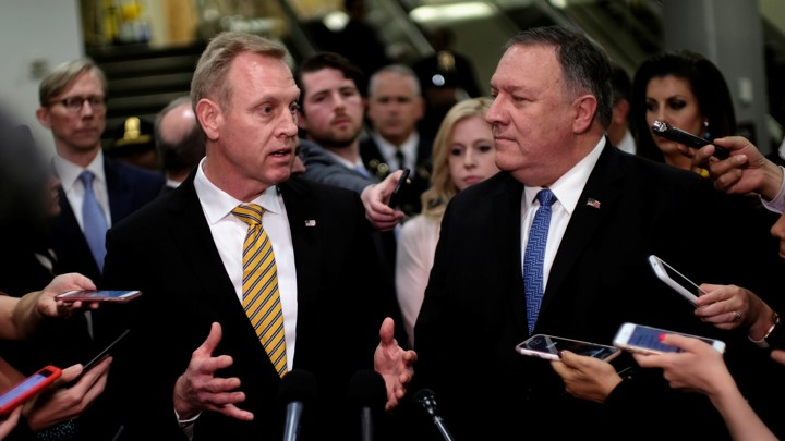 Acting Defense Secretary Patrick Shanahan and Secretary of State Mike Pompeo surrounded by reporters
