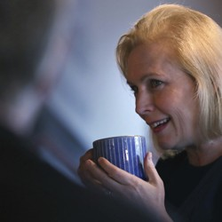 Senator Kirsten Gillibrand holding a cup of coffee