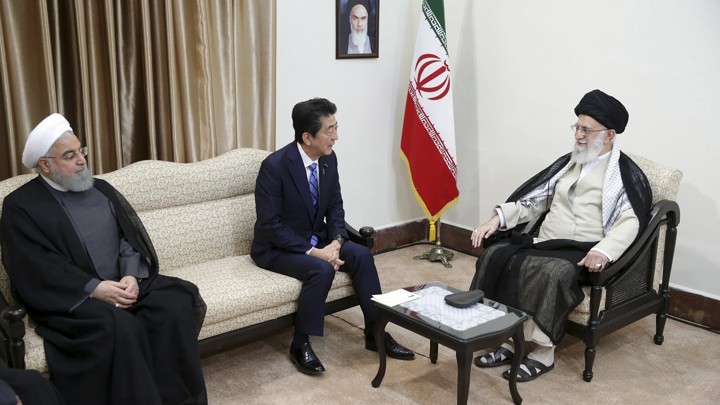 Iranian President Hassan Rouhani, Japanese Prime Minister Shinzo Abe, and Ayatollah Ali Khamenei meet in Tehran on June 13.