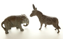Two figurines of a donkey and an elephant