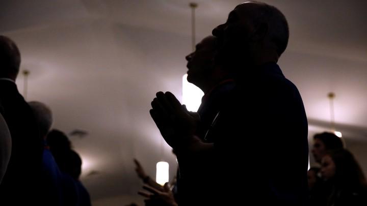 Members of a Baptist church pray.