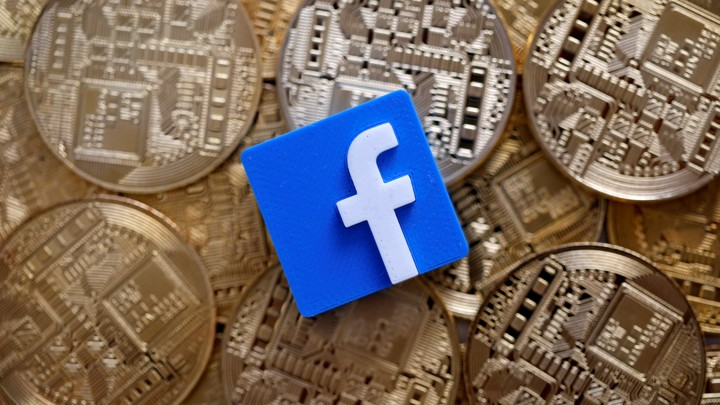 A 3-D printed Facebook logo is seen on representations of the bitcoin virtual currency in an illustration picture