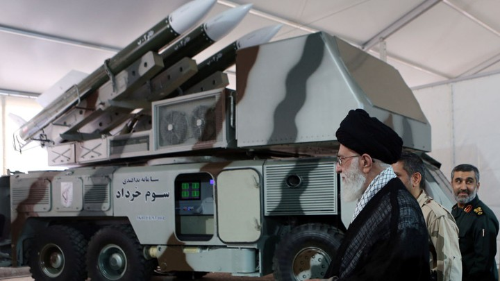 "Ayatollah Ali Khamenei is seen near a ""3 Khordad"" system, which is said to have been used to shoot down a U.S. military drone."