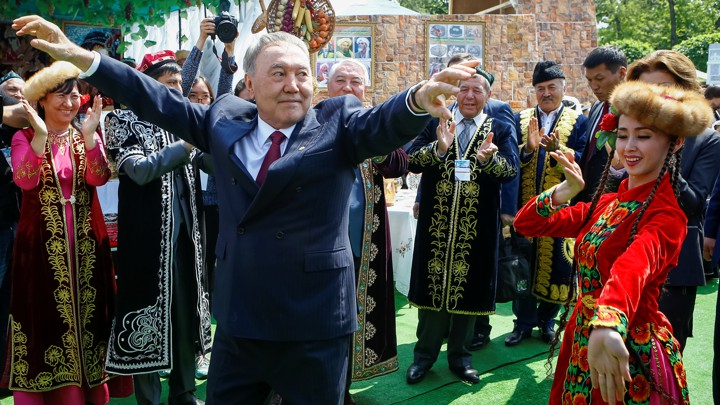 Former Kazakh President Nursultan Nazarbayev dances at a celebration for Kazakhstan People's Unity Day in 2016.
