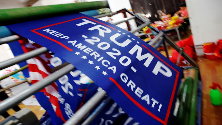 Flags for Donald Trump's reelection campaign at a factory in China in 2018
