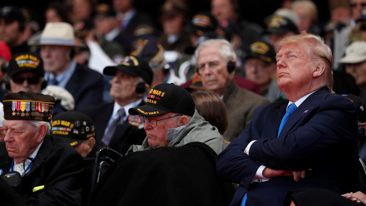 Donald Trump attends a D-Day commemoration in Normandy.