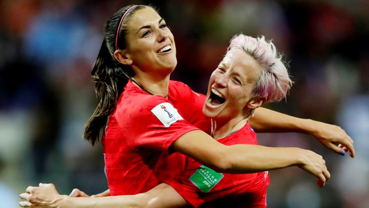 Alex Morgan (<i>left</i>) and Megan Rapinoe celebrate a goal during the World Cup match on Tuesday.