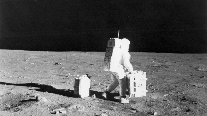 Buzz Aldrin moves equipment on the moon.